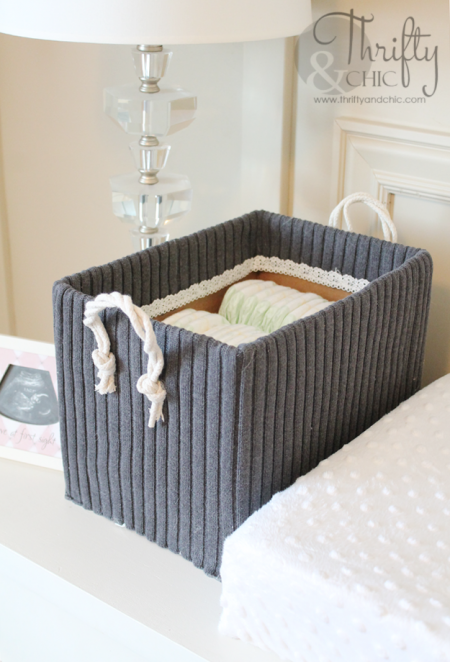 diy storage box created by outfitting an old diaper box in a sweater