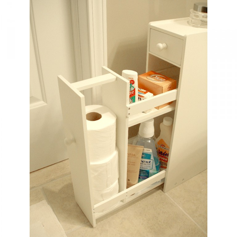 A Thin White Proman Free Standing Cabinet Is Next To A Wall And Storing  Various