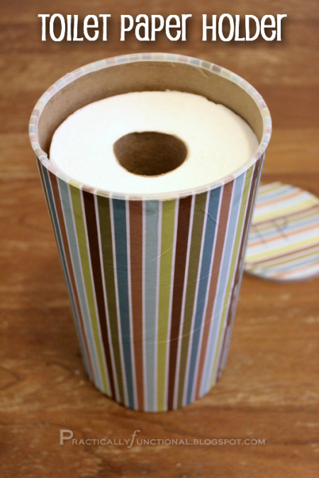 a decorated oatmeal cannister used for toilet paper storage