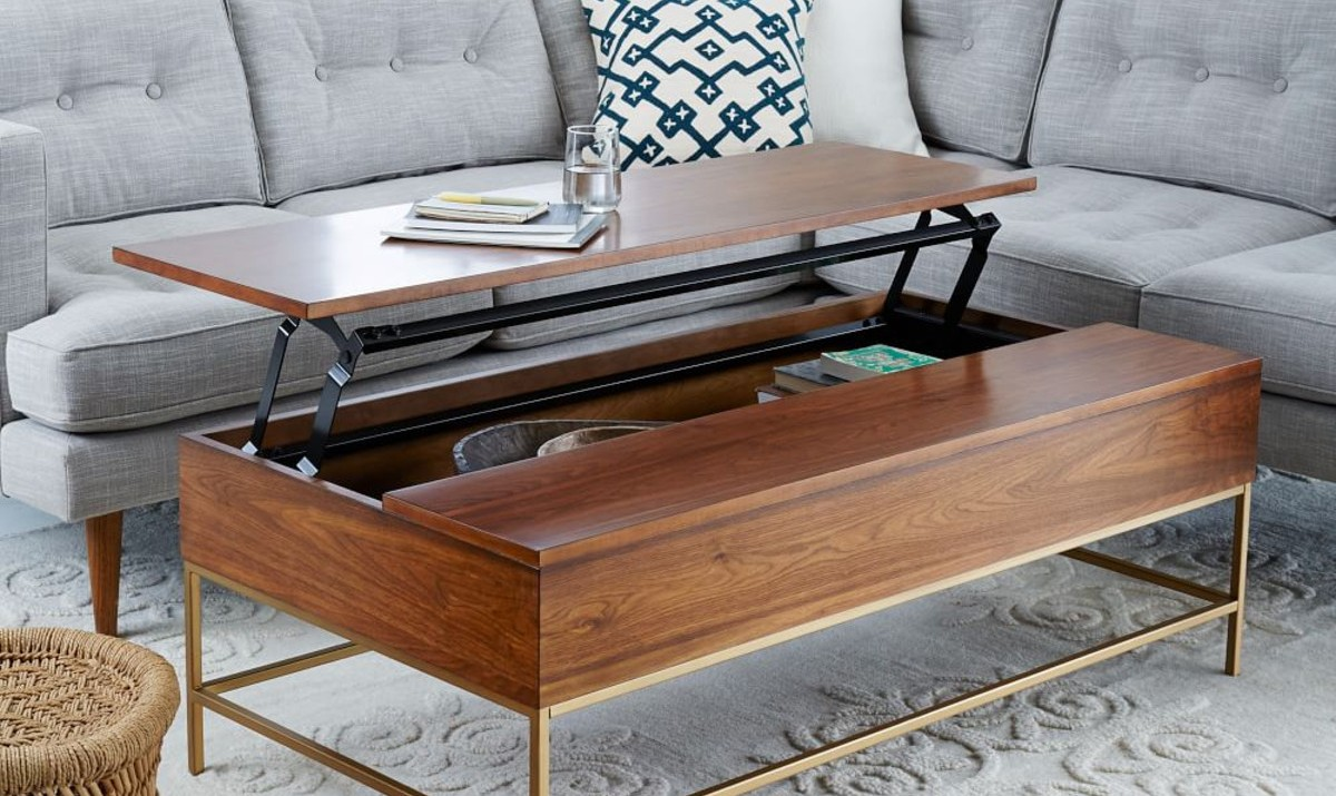 8 best coffee tables for small spaces for Small craft table with storage