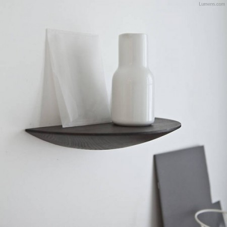a gridy fungi floating shelf from lumens storing a white decorative vase