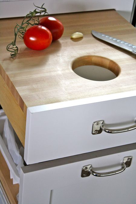 kitchen drawer hack: pull-out cutting board with a hole in the middle for throwing out scraps