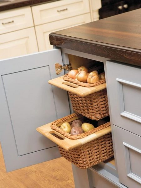 genius kitchen cabinet storage hack: pull-out wicker baskets for storing onions and potatoes