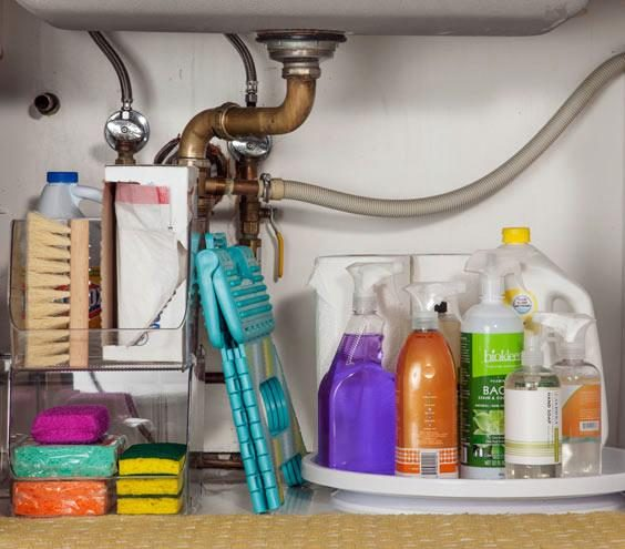 place a lazy susan in a kitchen sink cabinet to store cleaning products