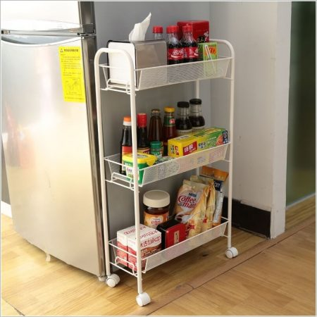 A Thin White Rack With Wheels Is One Of Many Smart Kitchen Storage Solutions For Small