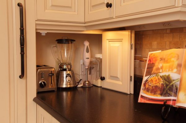 storage hacks for small apartments: build a kitchen appliance garage using a cabinet door