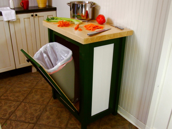 a butcher block/pull-out trash can is a creative diy kitchen storage idea