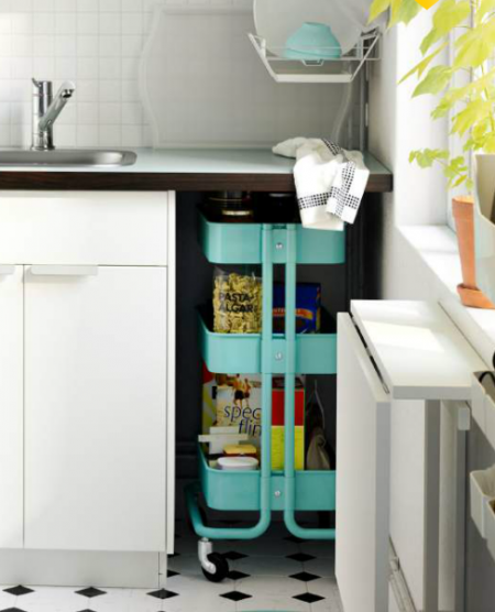 using an ikea raskog utility cart to store kitchen supplies or jars and boxes of food is a smart and affordable kitchen storage solution