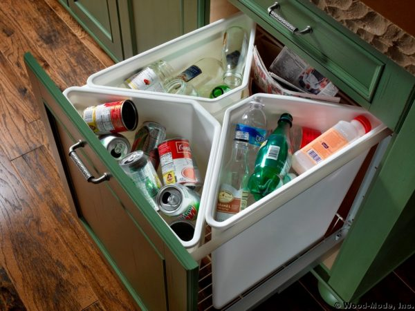 a 4-compartment recycling center that pulls out from a kitchen cabinet is a brilliant diy idea
