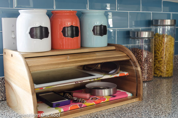 a diy breadbox charging station on a kitchen counter