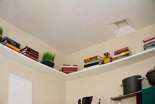 Bedroom Storage Shelves Installed Along The Perimeter Of A Wall