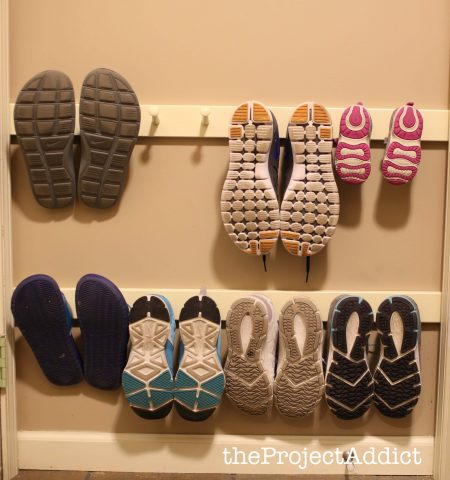 diy shoe storage hack made from wall-mounted boards with pegs