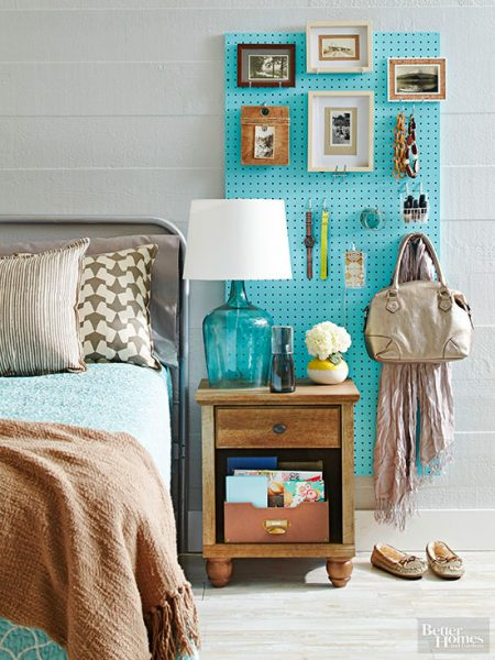 diy pegboard organizer storing picture frames, watches, bracelets, a handbag, a scarf, and more