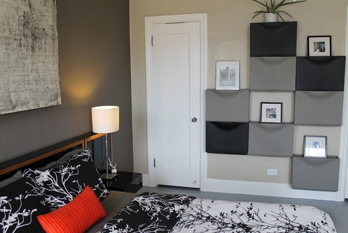 a wall of gray and black ikea trones is a stylish and cheap bedroom storage solution