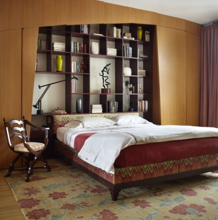 master bedroom headboard bookcase in an apartment at east lake shore drive in chicago, illinois