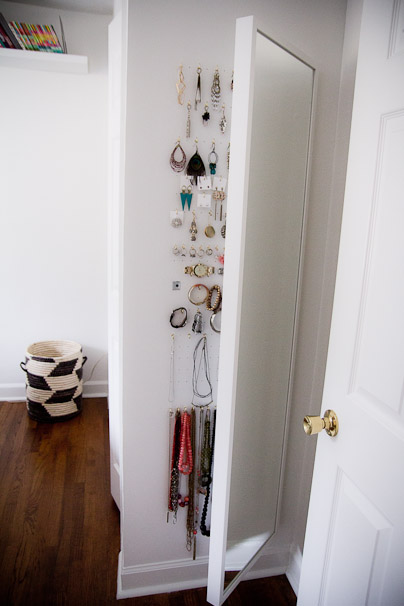 wall-mounted diy mirror jewelry cabinet in a bedroom