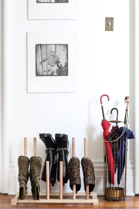 diy dowel shoe rack storing boots in an apartment