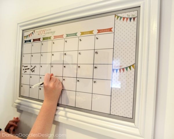write moving day on diy dry erase calendar