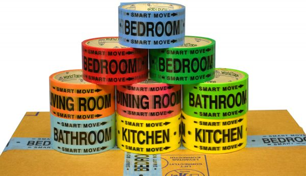 rolls of yellow, orange, red, pink, green, and blue color-coded moving tape with rooms printed on it are on top of a packed box
