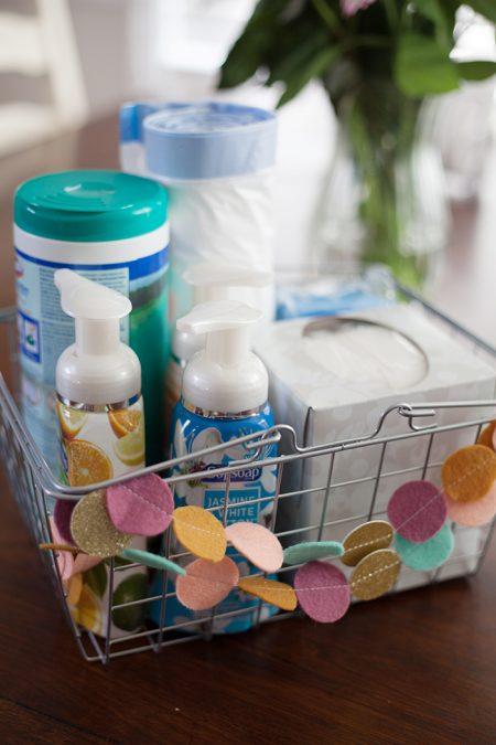 diy moving survival kit with clorox wipes, softsoap, hand lotion, a tissue box, and trash bags