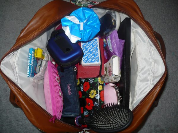 what to pack in overnight bag for moving: clothes, toiletries, water, laptop, snacks, gum