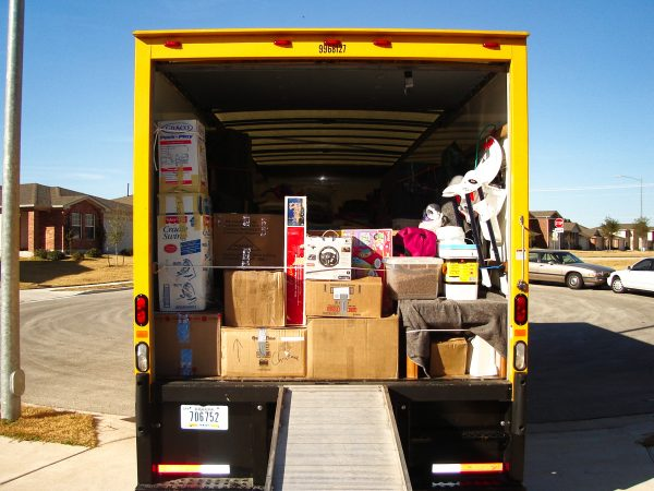 how to load a moving truck: load heavy items like a sofa first, followed by light items like boxes and chairs