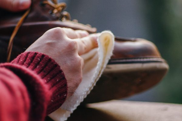 rubbing a leather boot with a cleaning cloth is an easy way to clean boots