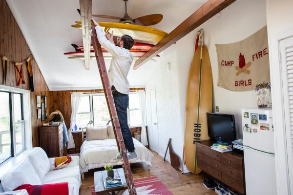 A rafters surfboard ceiling rack in a Montauk beach house