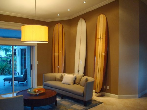 Wall surf racks for surfboard storage in a studio apartment