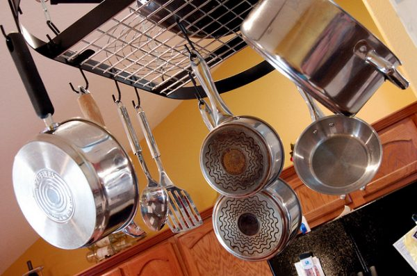 hanging pot rack attached to kitchen ceiling