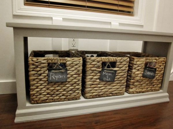 diy shoe baskets and storage bench in an entryway