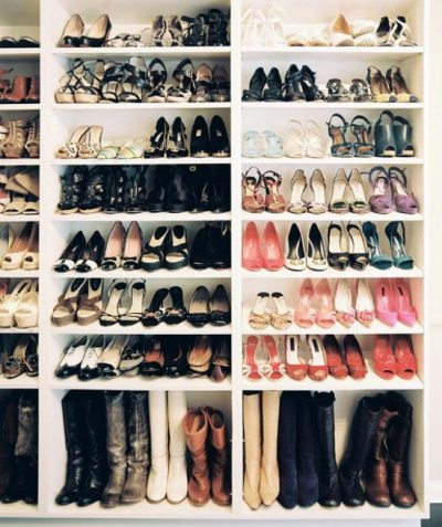 Organized Shoes And Boots On Shelves