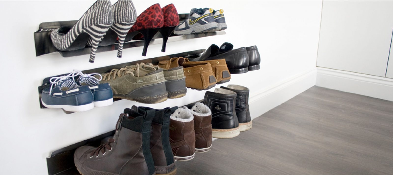 shoes, boots, sneakers, and heels stored on wall-mounted shoe racks
