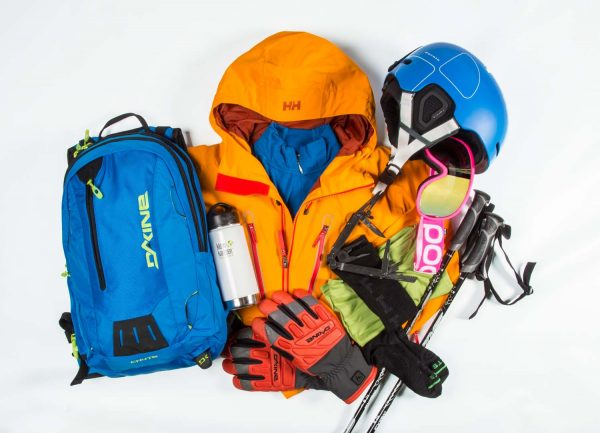 skiing equipment consisting of ski poles, googles, jacket, backpack, helmet, gloves, socks, canteen, and tools
