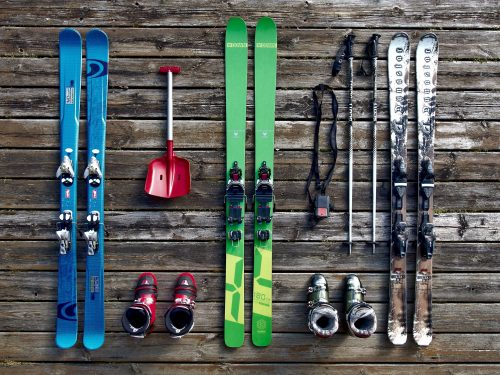 skis, ski boots, ski poles, and a shovel