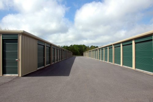 self-storage units with green doors