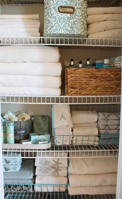 best way to organize small linen closet: store linens and toiletries in storage baskets, crates, bins, and trays
