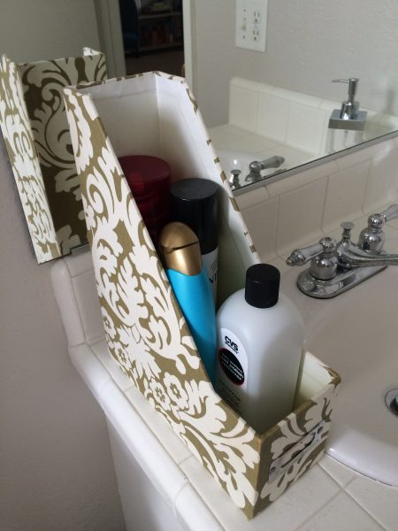 fleur-de-lis file holder as a shampoo and hairspray bottle holder in a bathroom