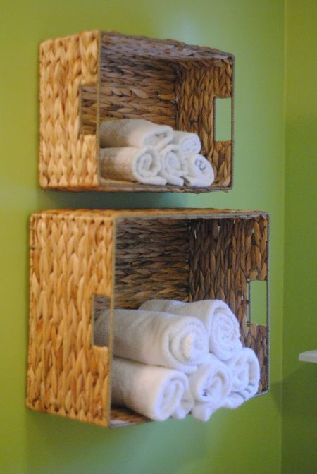 diy bathroom towel storage baskets mounted on a wall