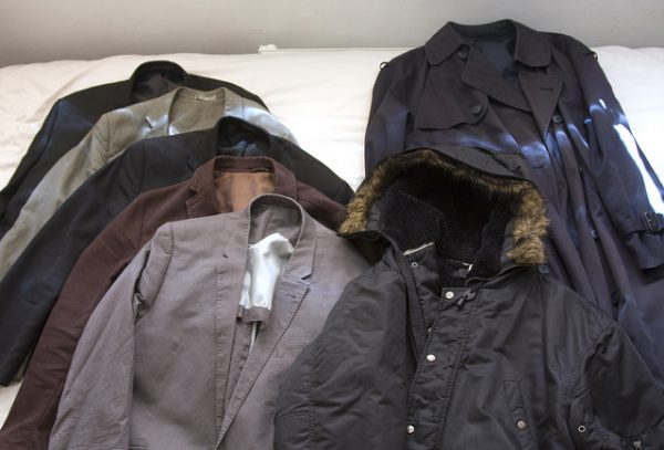 organize jackets and coats on bed