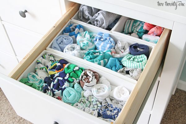 organized nursery dresser storing baby clothes