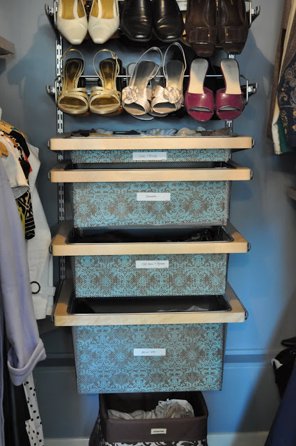 organized master closet with shoe racks and pull-out storage bins