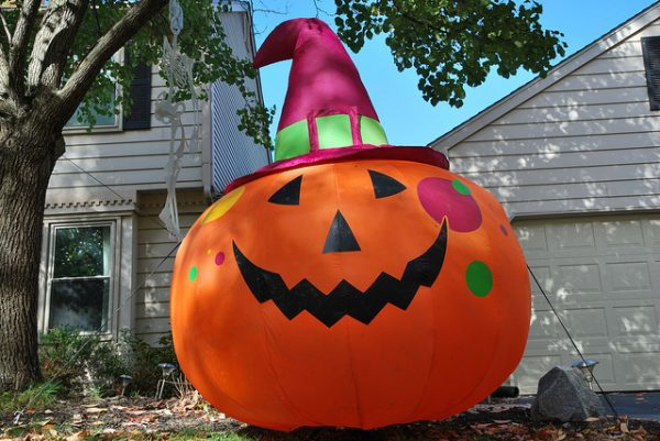 inflatable jack o lantern in a house's front yard