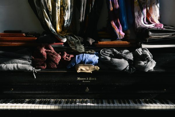 clothes on top of a mason risch piano