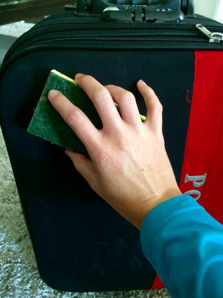inspect and clean luggage with a damp cloth for the interior, and warm water and a sponge for the exterior