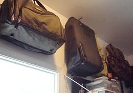 hang suitcase, duffel bag, and luggage on wall hooks