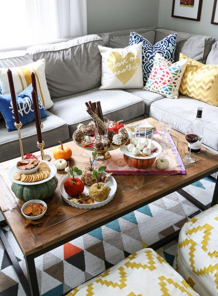friendsgiving coffee table setting in an apartment living room