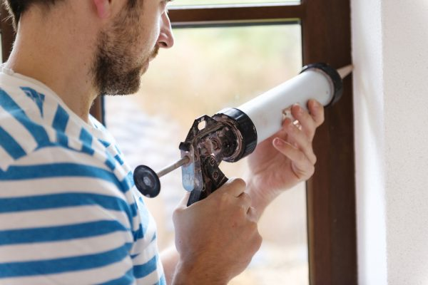 caulking windows to stop wind from coming through