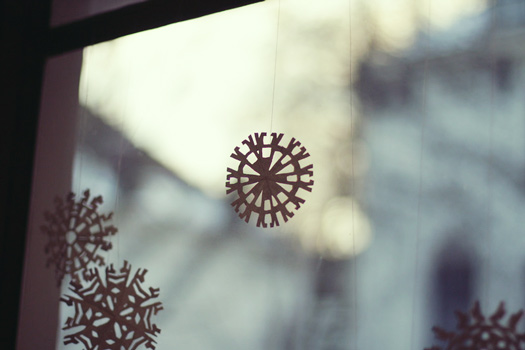 stick paper snowflakes on windows