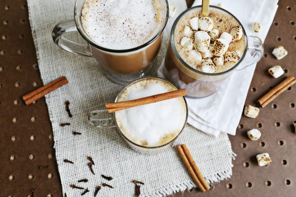 3 glasses of non-dairy latte, chai, and mocha with marshmallows and cinnamon sticks